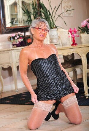 Nerdy mature lady with small untanned titties gladly poses in single gallery