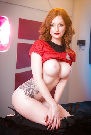 Space officer with red hair and also round boobs loves showing her undressed assets