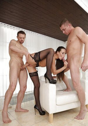 A couple of men team up to penetrate beauty in black stockings in all tight holes