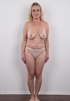 Dirty aged dame has saggy titties and belly but still poses undressed in studio