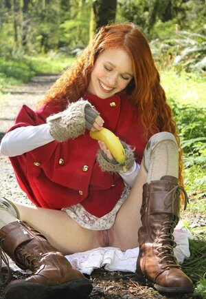 Small Red Riding Hood lost in the woods using banana to jerk off vagina
