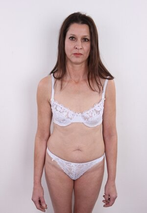 Middle-aged dame denudes what is hidden under white underwear more than often