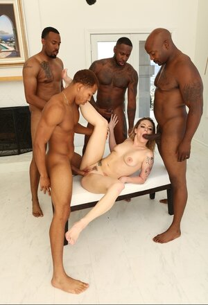 Hungry slut dragged into interracial gangbang sex with four Ebony stallions