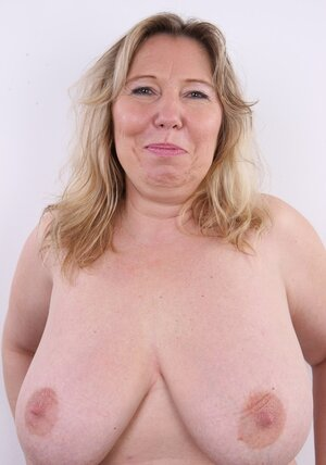 Old dame flaunts ample natural tits and tushy for all the prying eyes