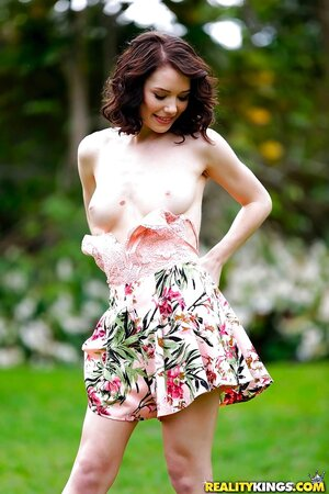 Naughty brunette during walk on field remains with no clothes on slim body