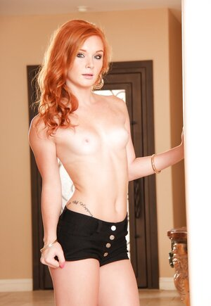 Red-haired beauty takes off clothes to welcome boyfriend fully naked
