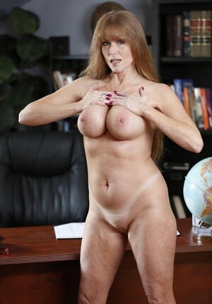 Debauched business female with big tits seduces unique assistant in her office
