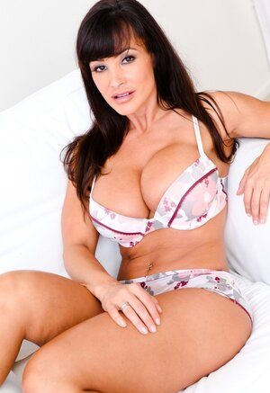 Spectacular adult video star Lisa Ann with massive tits poses wearing nice lingerie